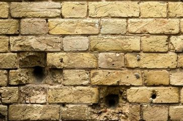 Holes in a brick wall